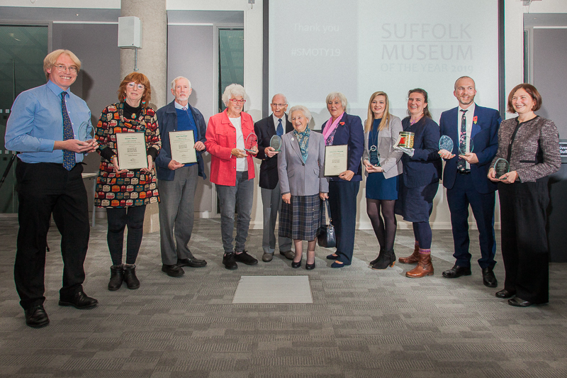 The winners of the Suffolk Museum of the Year Awards 2019 holding their trophies at the award ceremony